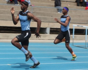 Track teams race to district titles