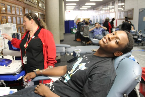 Antonio Polk, a junior, donates blood on Oct. 6 for the FCCLA Blood Drive. The blood drive was held in the north gym foyer.
