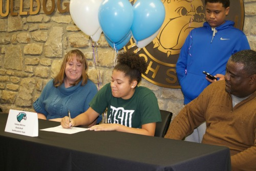 Tatiana McCree signs a letter of intent to play basketball next year for Northeastern State University. The signing ceremony was held Tuesday, Nov. 17 in the front foyer of GHS in front of McCree's teammates.