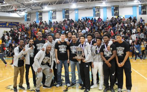 The GHS boys basketball team celebrates its first-ever state championship during a pep assembly at the school.