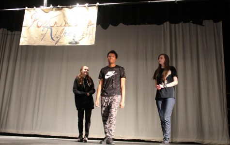 Poetry night winners, Sydney Walker, Justus McBride, and Samantha Lambert gather on stage on April 12th 2018.