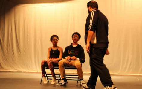 GHS theatre director Timothy Haynes works with middle school theatre students during a rehearsal for their production of Annie Jr.
