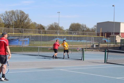 Freshman Luke Foster shakes hands with his Fort Osage opponent after a competitive match.