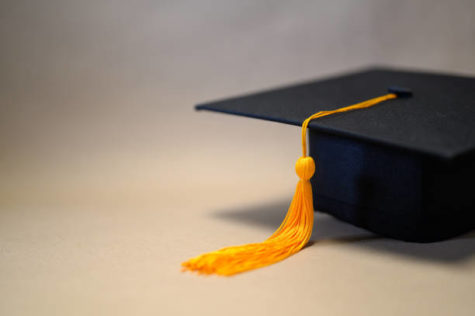 Black Graduation Hat placed on brown paper