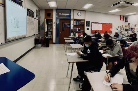 Students in Mr. Clarksons class solve Algebra equations. Photo by Julie Alsbury.